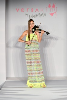 MIAMI BEACH, FL - JULY 13: a violinist performs at Versakini x Amanda Perna Runway Show Presented By Ivy at W South Beach on July 13, 2016 in Miami Beach, Florida. (Photo by Slaven Vlasic/Getty Images for Versakini)