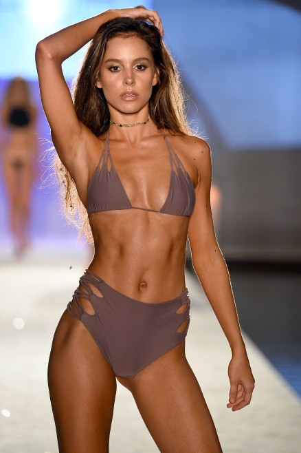 MIAMI BEACH, FL - JULY 15: A model walks the runway at KAOHS 2017 Collection at SwimMiami - Runway at W South Beach on July 15, 2016 in Miami Beach, Florida. (Photo by Frazer Harrison/Getty Images for KAOHS)