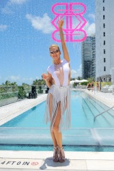 MIAMI BEACH, FL - JULY 16: A model poses by the runway at the Revel Rey 2017 Collection at SwimMiami - Runway at W South Beach on July 16, 2016 in Miami Beach, Florida. (Photo by Sergi Alexander/Getty Images for Revel Rey)