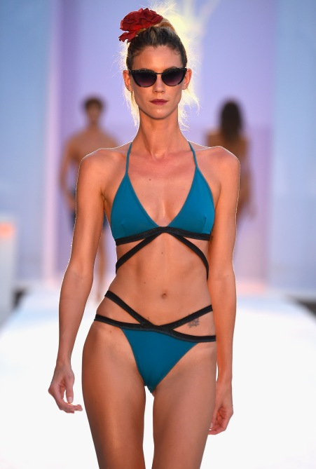 MIAMI, FL - JULY 17: A model walks the runway at Filthy Haanz 2017 Collection during SwimMiami at The W Hotel South Beach on July 17, 2016 in Miami, Florida. (Photo by Frazer Harrison/Getty Images for Filthy Haanz)