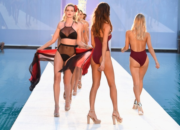 MIAMI, FL - JULY 17: Models walk the runway at Filthy Haanz 2017 Collection during SwimMiami at The W Hotel South Beach on July 17, 2016 in Miami, Florida. (Photo by Frazer Harrison/Getty Images for Filthy Haanz)