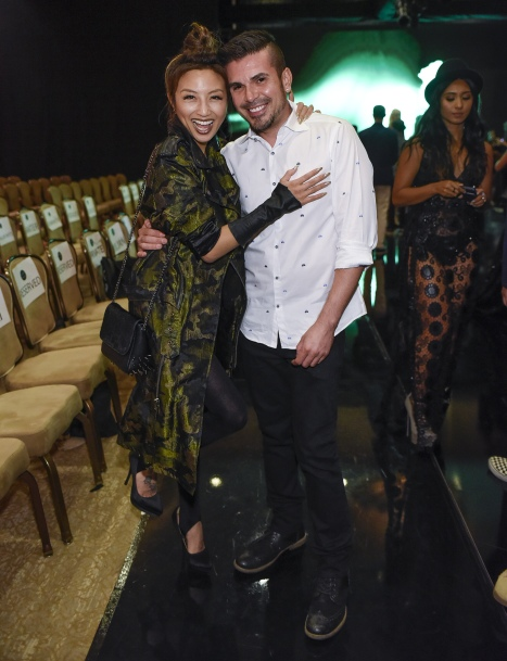 LOS ANGELES, CA - OCTOBER 09: T.V. personality Jeannie Mai (L) and Art Hearts Fashion founder and Mister Triple X designer Erik Rosete attend Art Hearts Fashion Los Angeles Fashion Week on October 9, 2016 in Los Angeles, California. (Photo by Arun Nevader/Getty Images for Art Hearts Fashion)