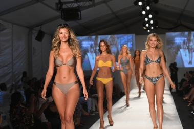 MIAMI, FL - JULY 21: Models walk the runway during the SWIMMIAMI Prey Swim by Audrina Patridge Resort 2018 Collection fashion show at The Tent on July 21, 2017 in Miami, Florida. (Photo by Rodrigo Varela/Getty Images for Prey Swim By Audrina Patridge)