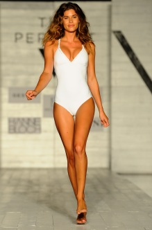 "MIAMI BEACH, FL - JULY 22: A model walks the runway wearing the designer brand ""Demadly"" at the SCANDINAVIAN CHIC fashion show presented by The PERFECT V during FUNKSHION Swim Fashion Week at Nautilus Hotel on July 22, 2017 in Miami Beach, Florida. (Photo by Serg Alexander/Getty Images for FUNKSHION Swim Fashion Week)"