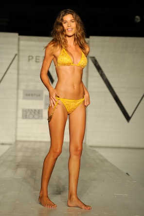 MIAMI BEACH, FL - JULY 22: A model walks the runway at the SCANDINAVIAN CHIC fashion show presented by PERFECT V during FUNKSHION Swim Fashion Week at Nautilus Hotel on July 22, 2017 in Miami Beach, Florida. (Photo by Serg Alexander/Getty Images for FUNKSHION Swim Fashion Week )