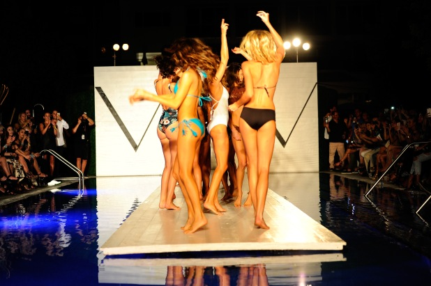 MIAMI BEACH, FL - JULY 22: Models dance on the runway at the SCANDINAVIAN CHIC fashion show presented by PERFECT V during FUNKSHION Swim Fashion Week at Nautilus Hotel on July 22, 2017 in Miami Beach, Florida. (Photo by Serg Alexander/Getty Images for FUNKSHION Swim Fashion Week )